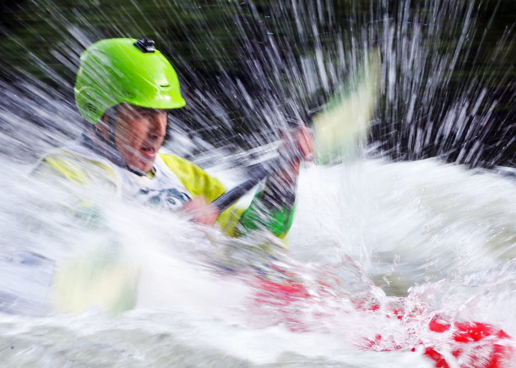 A kayaker goes through some rapids on the Roaring Fork River during the fifth annual Slaughter Fest race on July 12, 2019. The race, for kayakers, rafters or the daring stand-up paddleboarder, started at Henry Stein Park and finished at Jaffee Park in Woody Creek.