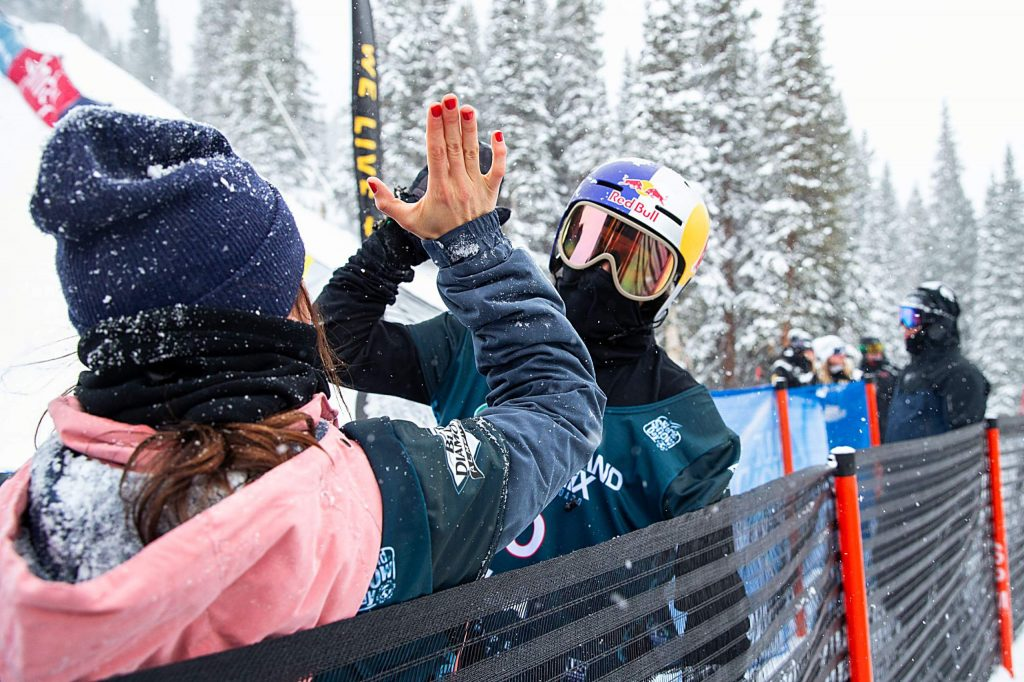 Toby Miller (right) high fives Queralt Castellet on her first place finish in the snowboarding halfpipe finals in the Land Rover U.S. Grand Prix at Copper Mountain, Colo. on Saturday, Dec. 14.