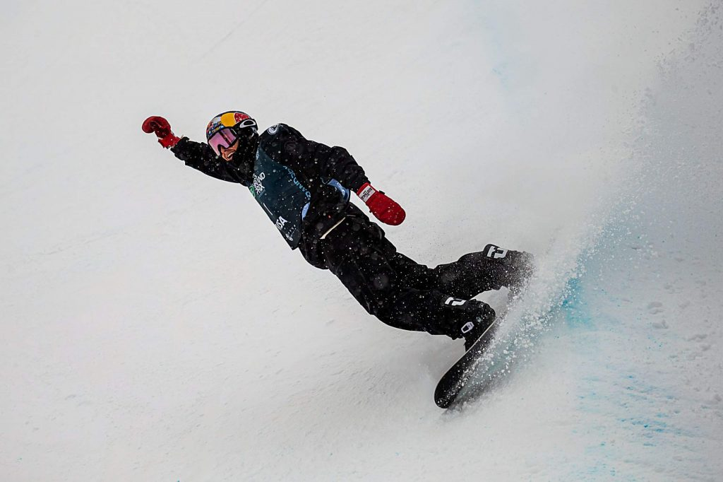 Pumping his fist in the air, Australian Scotty James scores a 96.00 on his first run of the snowboarding halfpipe finals at the Land Rover U.S. Grand Prix at Copper Mountain, Colo. on Saturday, Dec. 14. For the third year in a row, James placed first in the competition.