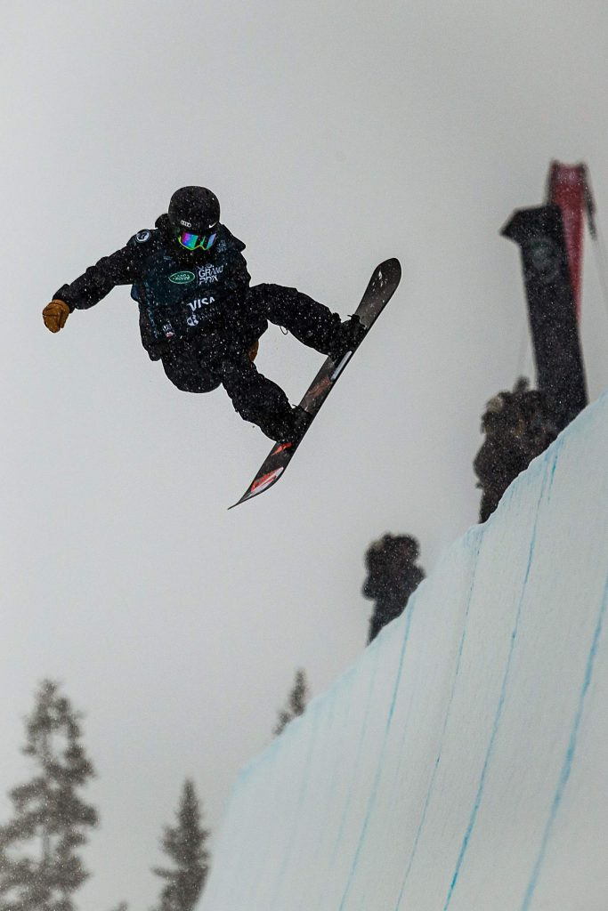 China's Xuetong Cai hits a jump on her second run of the snowboarding halfpipe finals at the Land Rover U.S. Grand Prix at Copper Mountain, Colo. on Saturday, Dec. 14.