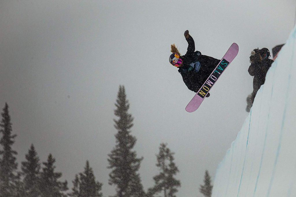 Maddie Mastro hits a jump on her second run of the snowboarding halfpipe finals from the Land Rover U.S. Grand Prix at Copper Mountain, Colo. on Saturday, Dec. 14. With the low visibility and heavy snowfall, Mastro placed third in the competition with a score 77.50.
