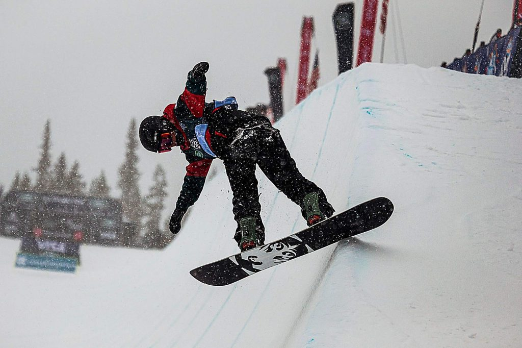Chase Blackwell finishes up his second run in the snowboarding halfpipe finals of the Land Rover U.S. Grand Prix at Copper Mountain, Colo. on Saturday, Dec. 14.