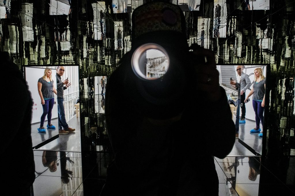Lea Tucker and Luis Yllanes open the door to the Infinity Mirror Room at the Aspen Art Museum on Wednesday, December 18, 2019. The photographer is also pictured here.