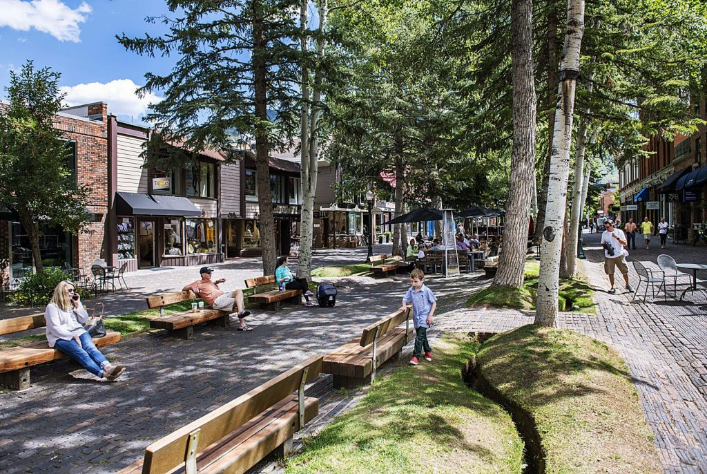 People mill around the walking mall on East Hyman Ave. in Aspen on Tuesday, September 10, 2019.