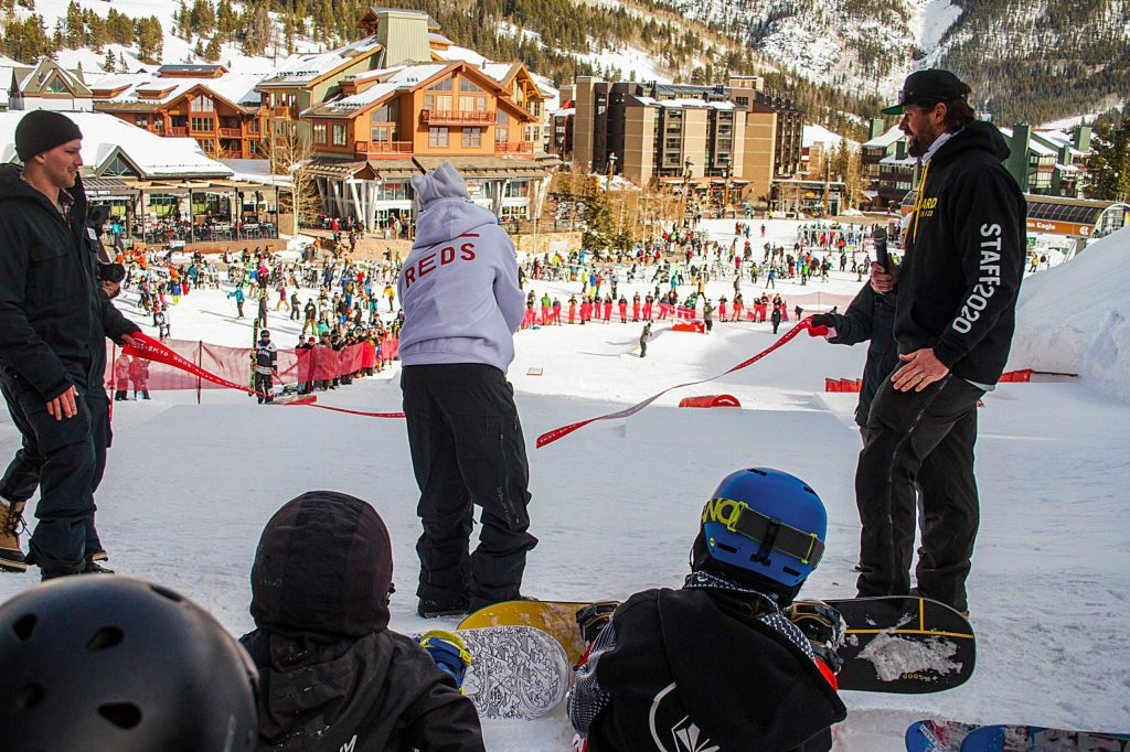 2018 Pyeongchang Olympic gold medalist and 2019 Burton U.S. Open champion Red Gerard of Summit County cuts the ribbon to officially open the new Red's Backyard rail garden at Copper Mountain Resort on Monday morning.