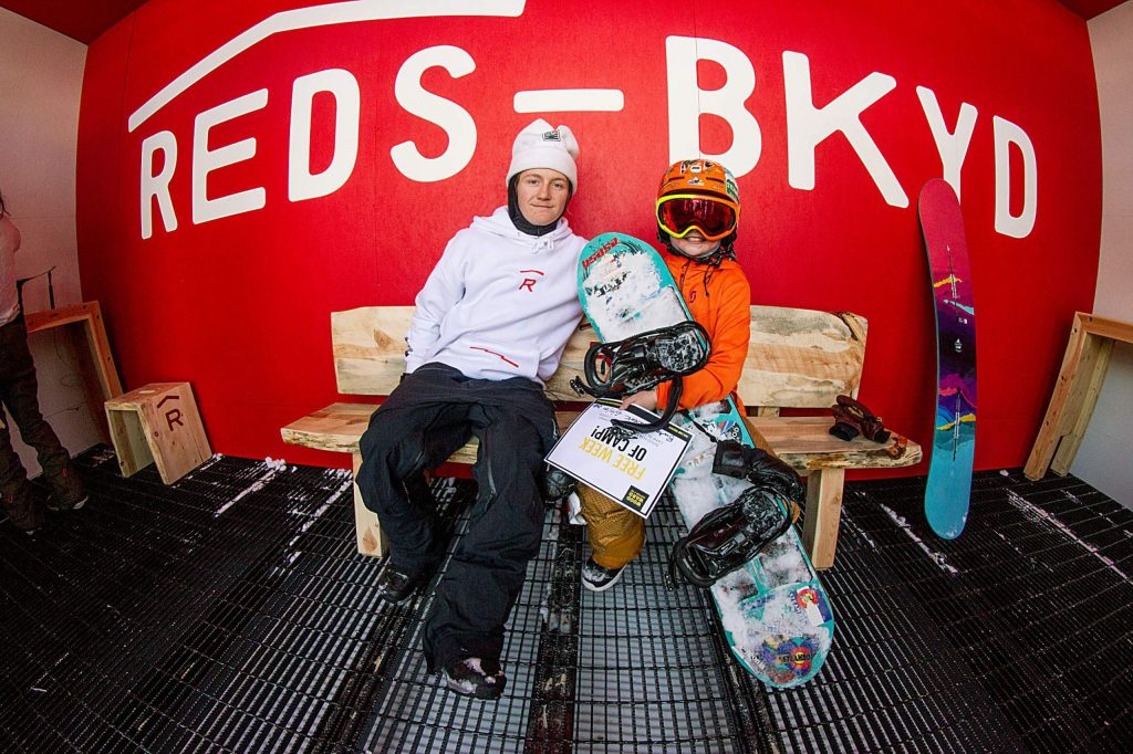 U.S. pro snowboarder Red Gerard poses for a photo with young Rocke Weinberg of Steamboat Springs after Rocke was selected by Red as the recipient of the free week of Woodward Copper summer camp during Burton Week.