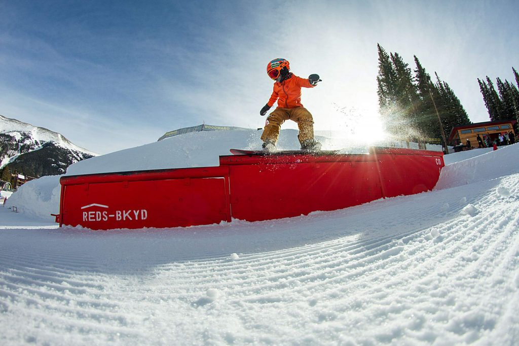 Rocke Weinberg of Steamboat Springs rides a rail during Monday's grand-opening Red's Backyard rail jam competition at Copper Mountain Resort.