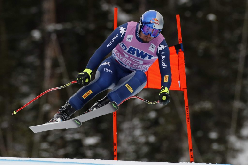 FILE - In this Dec. 7, 2019, file photo, Italy's Dominik Paris skis during a men's World Cup downhill skiing race in Beaver Creek, Colo. Paris writes his own lyrics as the lead singer of a heavy power metal band. Outside passions are a way for racers to take their minds off always thinking about racing. (AP Photo/Robert F. Bukaty, File)