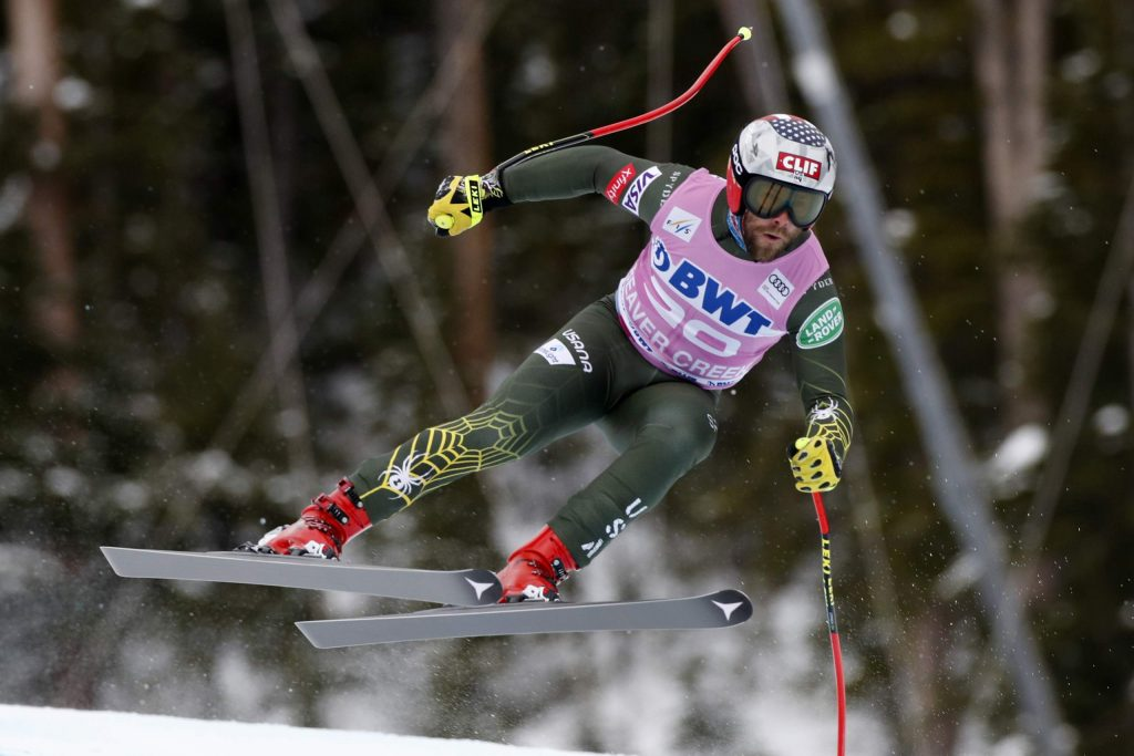 FILE - In this Dec. 7, 2019, file photo, United States' Travis Ganong skis during a men's World Cup downhill skiing race in Beaver Creek, Colo. Italian downhill racer Dominik Paris writes his own lyrics as the lead singer of a heavy power metal band. American Travis Ganong opened a coffee shop, while teammate Tommy Ford is into art (more specifically, drawing) and Alice Merryweather gives Tarot card readings. These outside passions are a way for racers to take their minds off always thinking about racing. (AP Photo/Robert F. Bukaty, File)