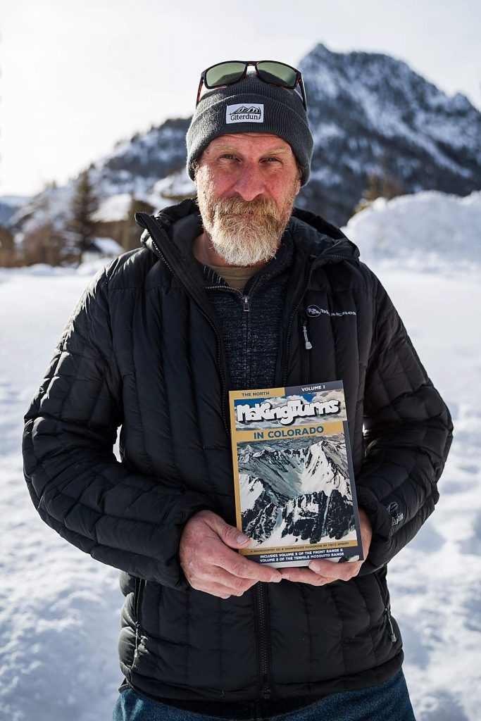 """Backcountry skier and author Fritz Sperry poses for a photo in front of Wichita Mountain in Frisco on Dec. 18, with his new book """"Making Turns in Colorado: The North."""""""
