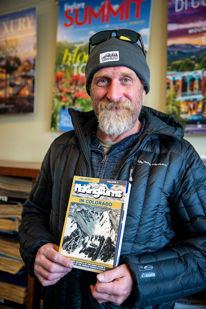 """Backcountry skier and author Fritz Sperry poses for a photo on Dec. 18, in Frisco with his new book """"Making Turns in Colorado: The North."""""""