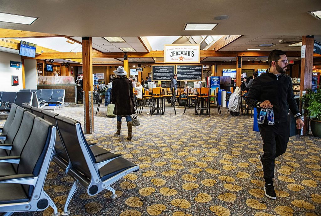 Travelers mill around the newly renovated terminal in the Aspen/Pitkin County Airport on Wednesday, December 18, 2019. The renovations gives travelers more space, which improves safety. (Kelsey Brunner/The Aspen Times)