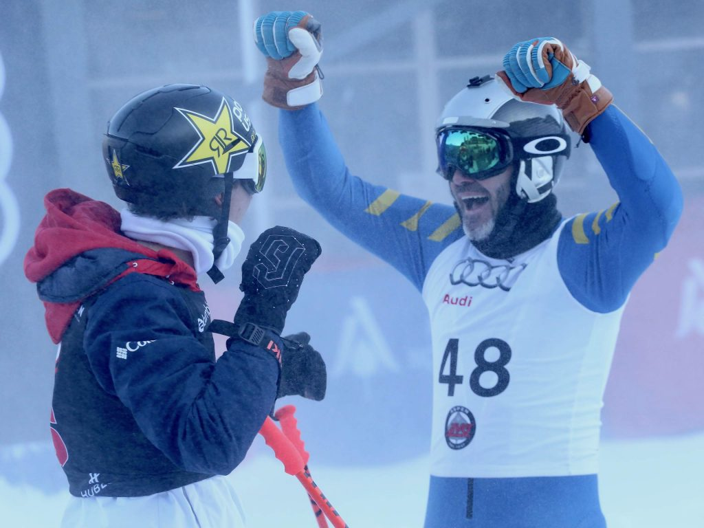 Aspen Olympian Alex Ferreira, left, and NASCAR driver Jimmie Johnson celebrate after Ferreira clinched the Audi Ajax Cup championship for Johnson's team on Monday, Dec. 30, 2019, at Aspen Mountain. (Photo by Austin Colbert/The Aspen Times)