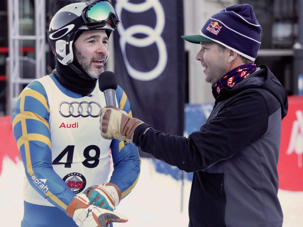 NASCAR driver Jimmie Johnson, left, is interviewed by Chris Davenport after winning the Audi Ajax Cup on Monday, Dec. 30, 2019, at Aspen Mountain. (Photo by Austin Colbert/The Aspen Times)