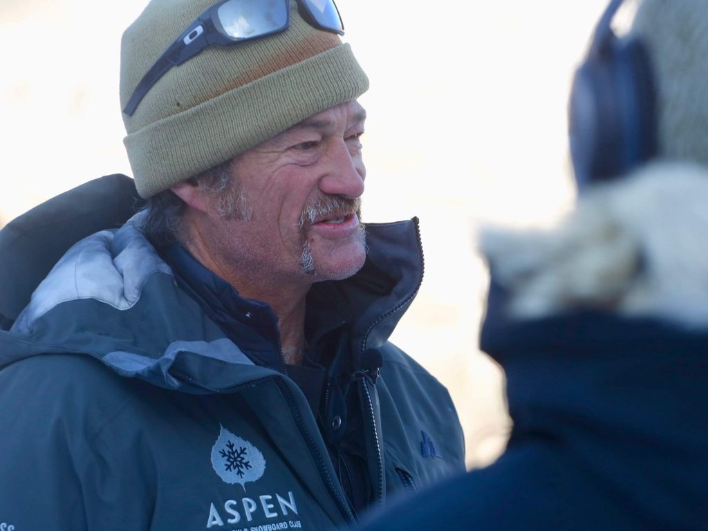 AVSC coach Johno McBride is interviewed during the Audi Ajax Cup on Monday, Dec. 30, 2019, at Aspen Mountain. (Photo by Austin Colbert/The Aspen Times)
