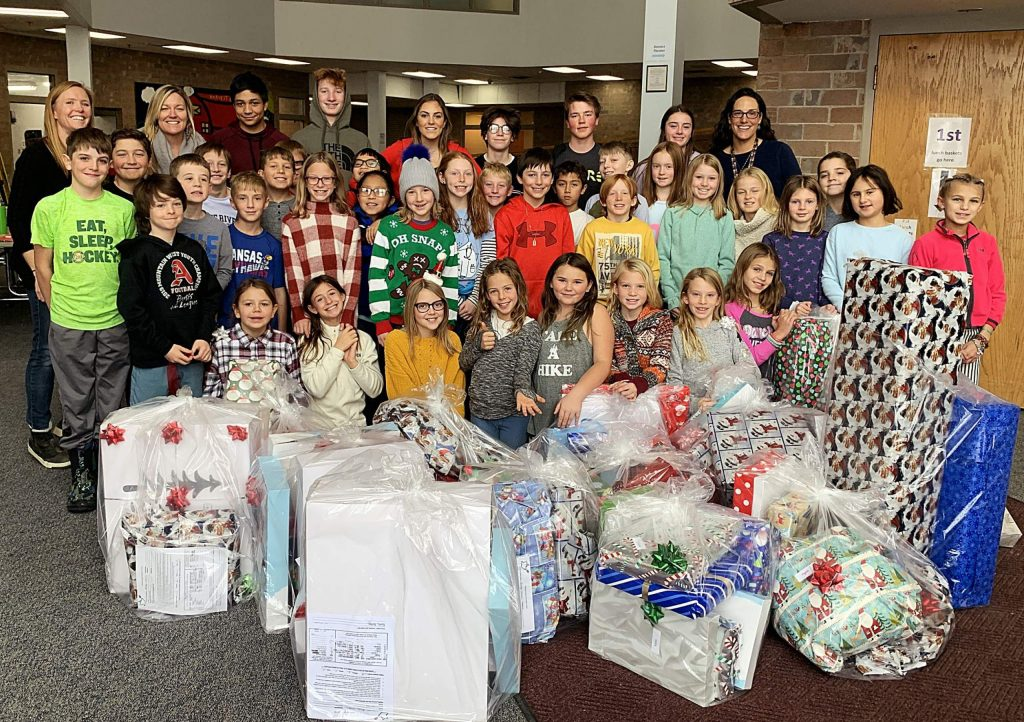 Teacher Becky Oliver's ExEd group from the high school and Katie Fox and Kate Korn's fourth-graders raised a record amount of $4,000 for their recent Adopt-A-Family project. Through the local Holiday Baskets Program, they were able to adopt four families, 38 people total, in addition to donating their leftover money to the Holiday Baskets program. Teachers said the kids have worked on chores in their homes and the community since October. Prior to their school-wide bake sale, they had raised $3,290 by doing chores and setting up a GoFundMe campaign, in addition to several generous donations.