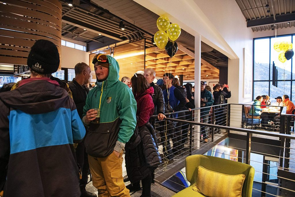 A line wraps around the inside of the brand new Collective as people wait for a free community meal during the grand opening of MixSix in Snowmass on Saturday, December 7, 2019. (Kelsey Brunner/Snowmass Sun)