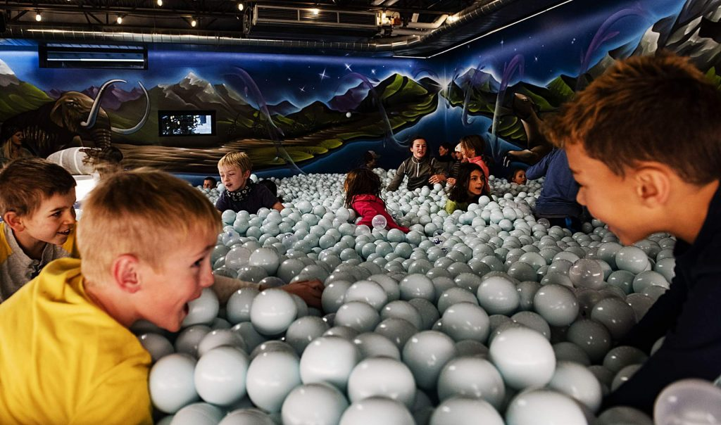 Kids play in the ball pool surrounded by artwork by Chad Bolsinger during the grand opening of The Collective and MixSix in Snowmass on Saturday, December 7, 2019. (Kelsey Brunner/Snowmass Sun)