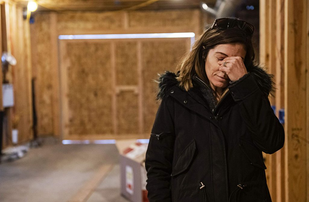 Tara Dakides wipes tears from her eyes while talking about the things her family lost in the fire, but how grateful she is that no one was hurt in the accident inside of the barn they're building on the family's property in Carbondale on Sunday, December 15, 2019.