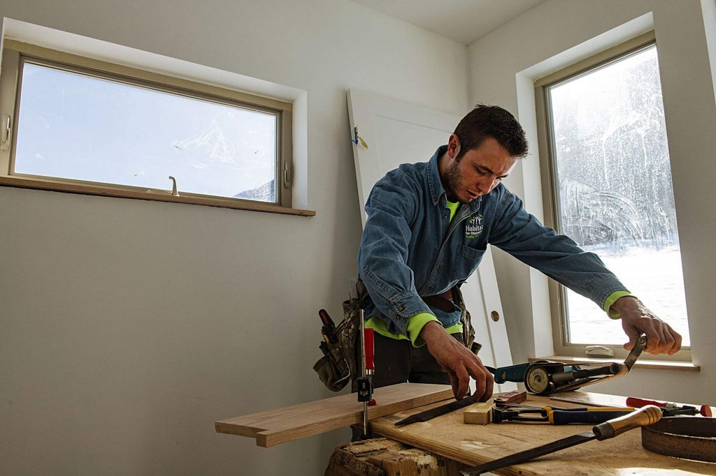 Habitat for Humanity build team member Trent Marshall constructs windowsills for the home in the Basalt Vista project.