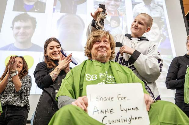 Red Cunningham gets his head shaved by his son Cooper at Basalt High School in February to honor his daughter, Anna, who was battling Ewing sarcoma. Anna, 16, passed away the next day.