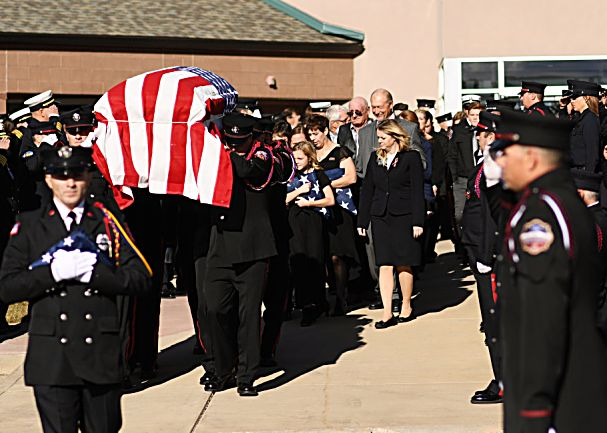 Hundreds gather for a funeral for Summit County firefighter Ken Jones, 46, at Waterstone Community Church on Friday in Littleton. Jones died after falling from a five-story condominium while fighting a fire at Copper Mountain.