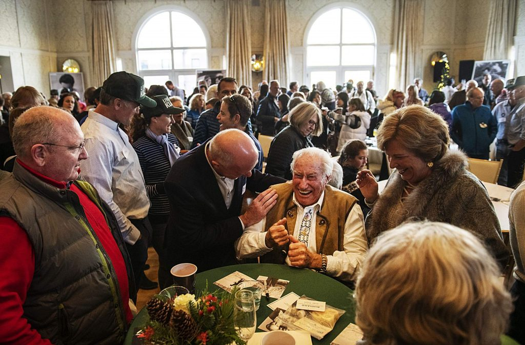 Klaus Obermeyer receives hugs and happy birthday wishes from a long line of fans Monday during his 100th birthday party at the Hotel Jerome.