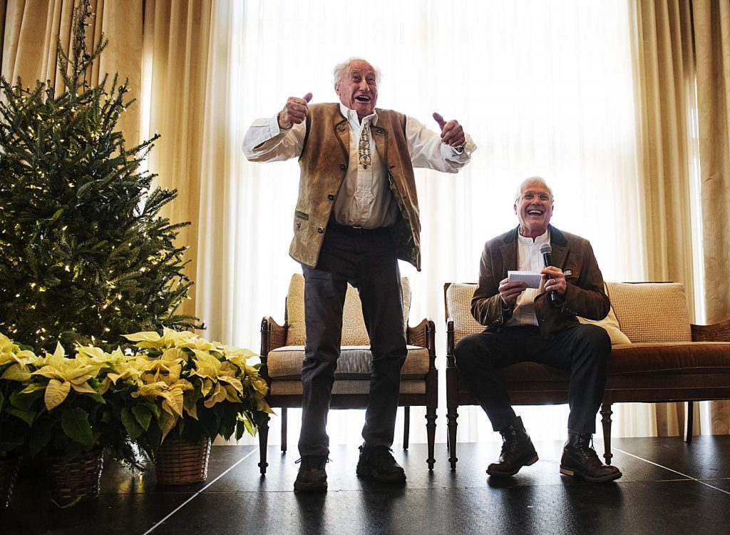 Klaus Obermeyer jokes with the crowd while on stage with his son Wally Obermeyer during Klaus's 100th birthday celebration in the Hotel Jerome on Monday.