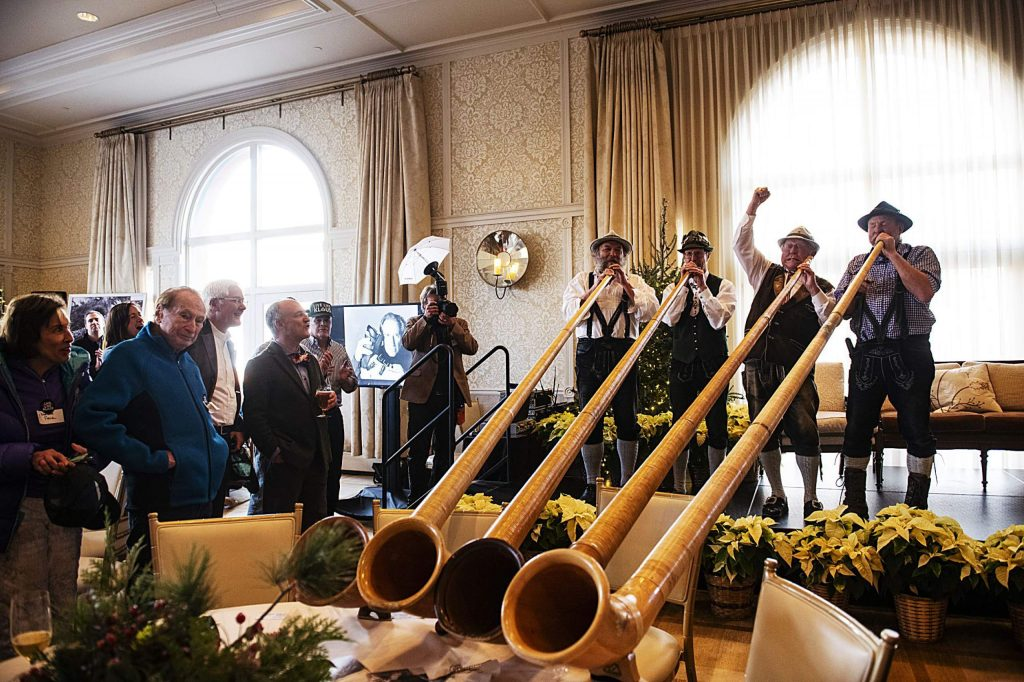 Musicians perform with alpenhorns during the 100th birthday celebration in the Hotel Jerome on Monday.