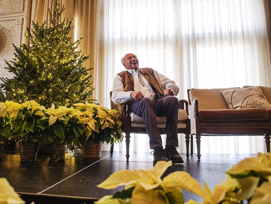 Klaus Obermeyer laughs with the crowd as people yell happy birthday wishes during his 100th birthday celebration in the Hotel Jerome on Monday.