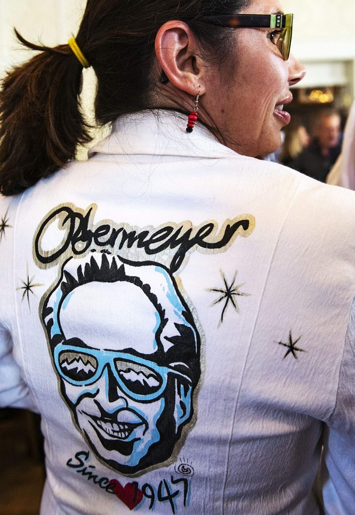 Adrienne Skaling wears her mother's handmade Obermeyer jacket during Klaus Obermeyer's 100th birthday celebration in the Hotel Jerome on Monday.