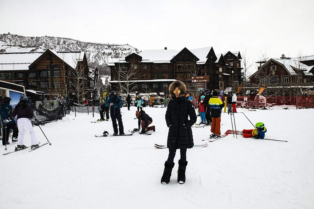 Skiers and snowboarders get ready to get on the Village Express Lift from Base Village during the Passapalooza event at Snowmass on Saturday, December 14, 2019.
