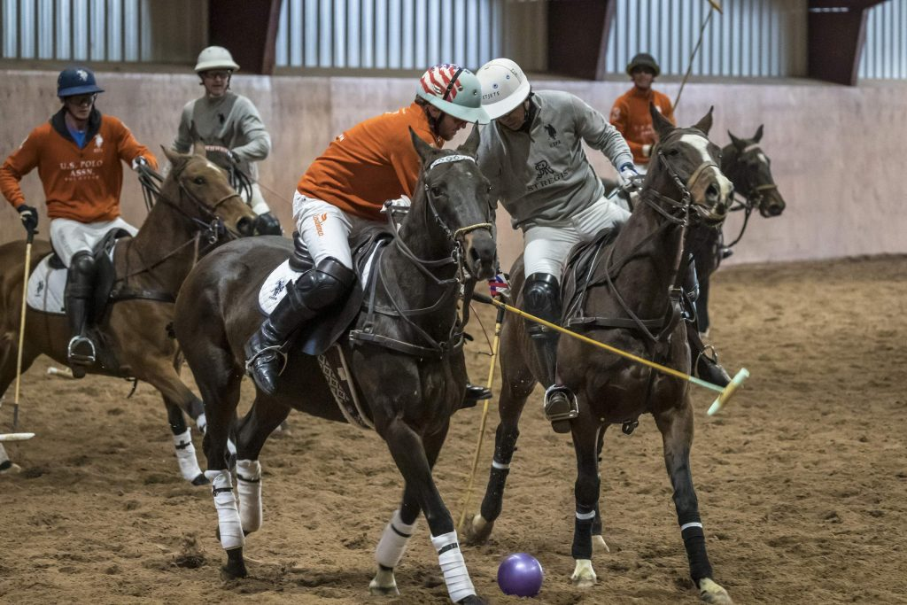 U.S. Polo Assn., in orange, plays St. Regis in the qualifying games of the World Snow Polo Championship on Wednesday, Dec. 18, 2019, at Aspen Valley Polo Club in Carbondale.