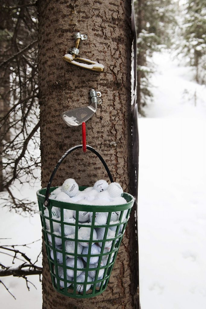 Golf balls hang on a tree in the Golf Shrine on Snowmass Mountain on Friday, December 27, 2019.