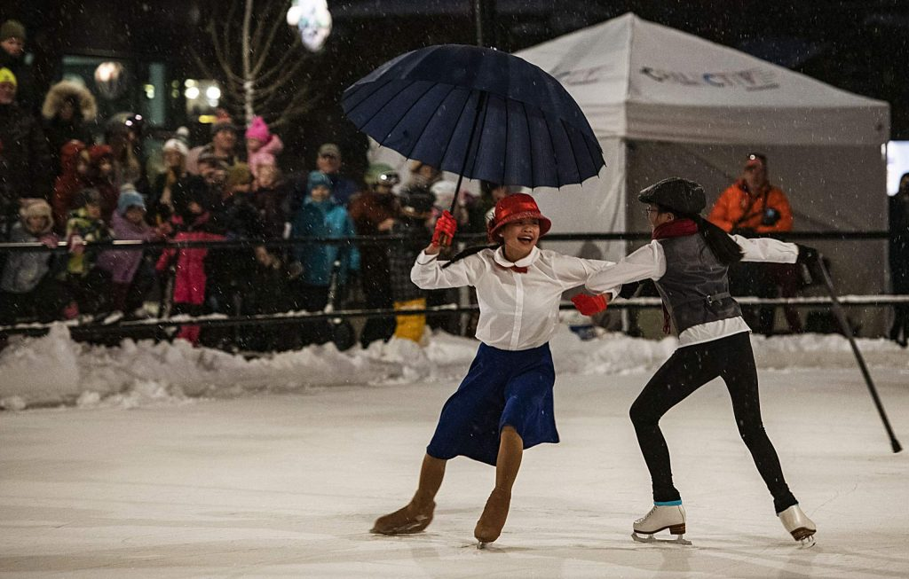 Audrey Solberg, 13, left, and Quynh Solberg, 13, perform a Mary Poppins inspired routine during the Snowmass ice show in Base Village Saturday, December 14, 2019.