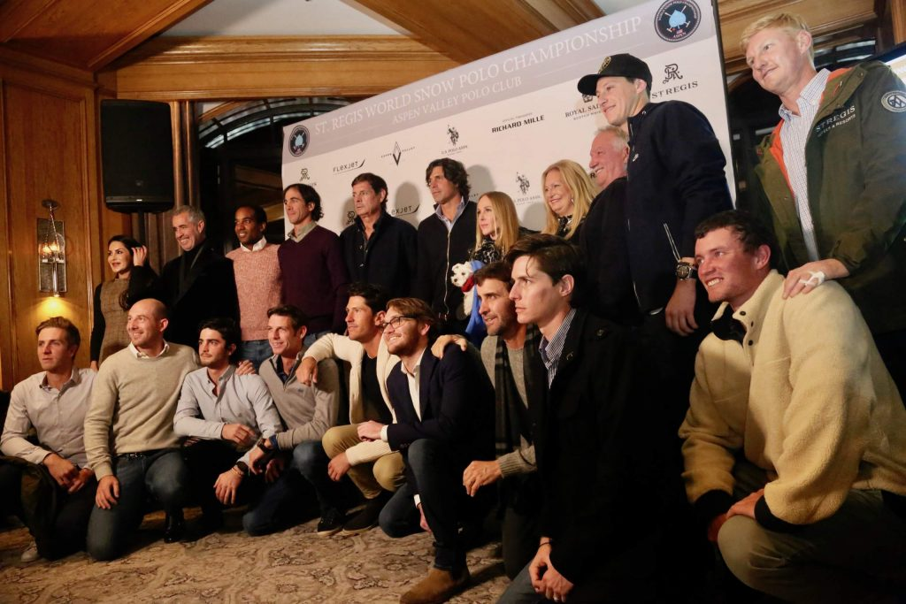 Players gather for a photo during the World Snow Polo Championships team draw on Tuesday, Dec. 17, 2019, inside the St. Regis Aspen.