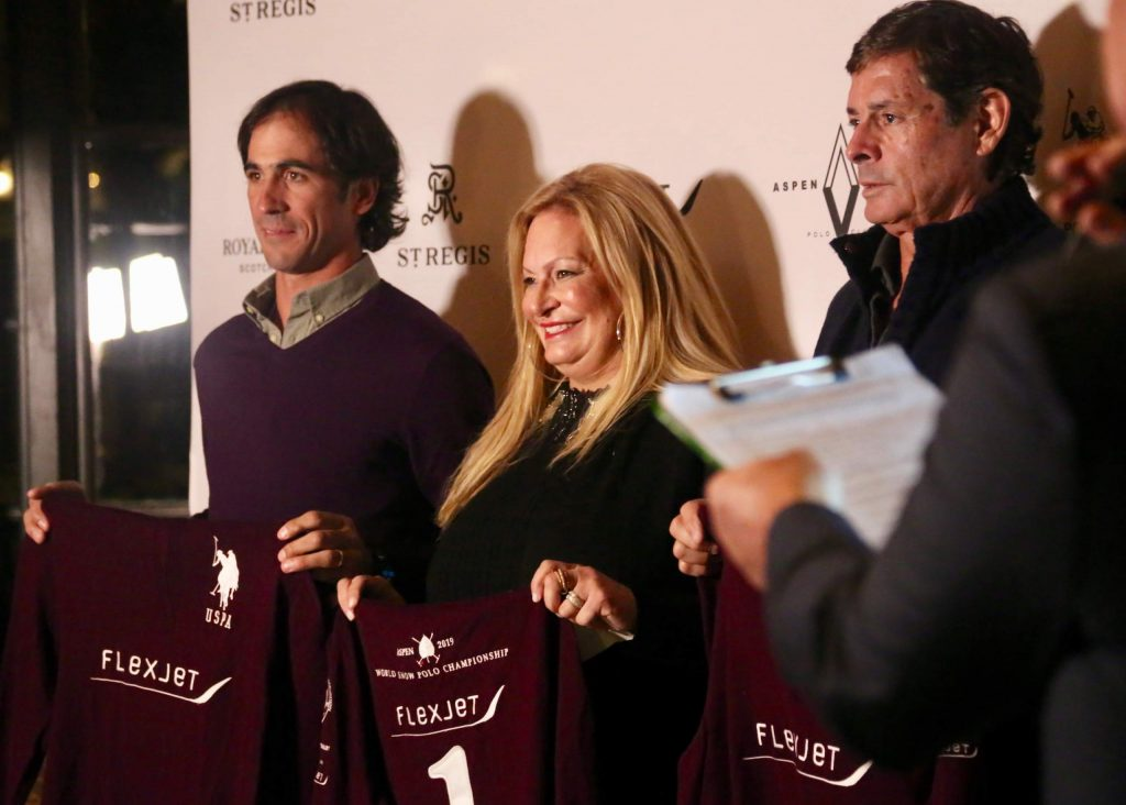 From left, Alejandro Novillo Astrada, Melissa Ganzi and Juan Bollini of team Flexjet pose during the World Snow Polo Championships team draw on Tuesday, Dec. 17, 2019, inside the St. Regis Aspen.