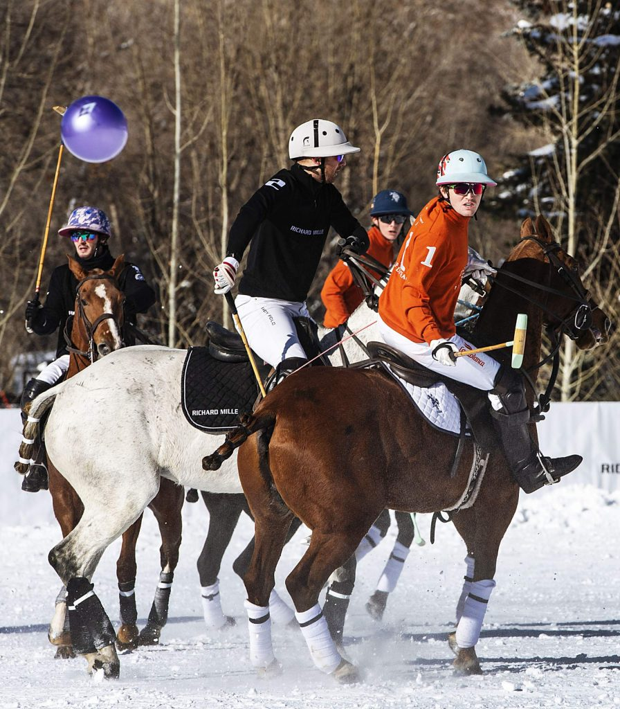 U.S. Polo Assn., in orange, and Richard Mille play in the final game at Rio Grande Park during the St. Regis World Snow Polo Championship in Aspen on Friday, Dec. 20, 2019. (Kelsey Brunner/The Aspen Times)