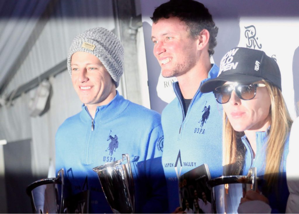 Aspen Valley Polo Club players pose on the podium after the World Snow Polo Championship on Friday, Dec. 20, 2019, at Rio Grande Park in Aspen. (Photo by Austin Colbert/The Aspen Times)