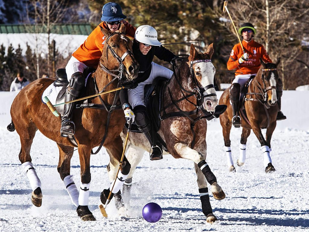Richard Mille, in black, and U.S. Polo Assn. play in the World Snow Polo Championship on Friday, Dec. 20, 2019, at Rio Grande Park. (Kelsey Brunner/The Aspen Times)