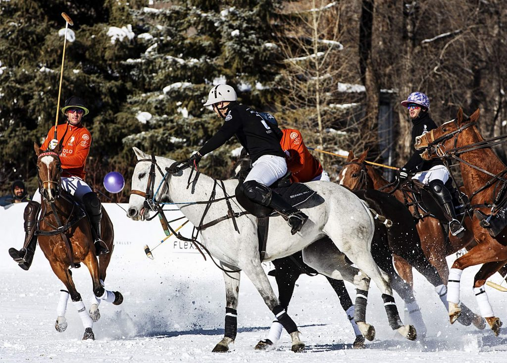 U.S. Polo Assn., in orange, and Richard Mille play in the final game at Rio Grande Park during the St. Regis World Snow Polo Championships in Aspen on Friday, Dec. 20, 2019. (Kelsey Brunner/The Aspen Times)