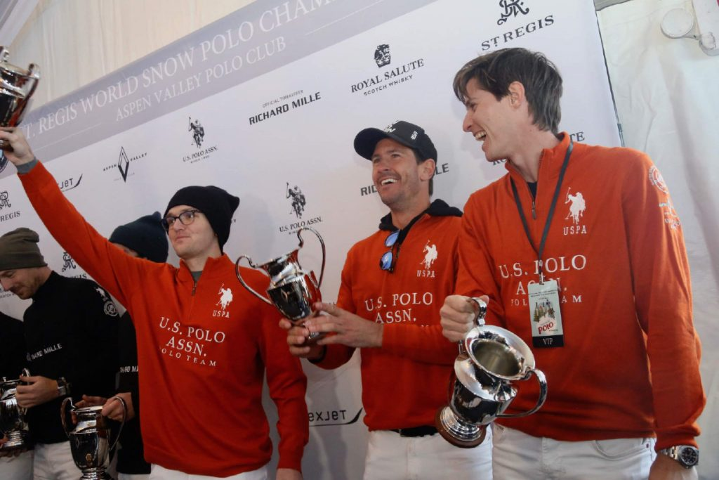 From left, U.S. Polo Assn. players Grant Ganzi, Nic Roldan and Juancito Bollini pose after finishing as the runner-up at the World Snow Polo Championship on Friday, Dec. 20, 2019, at Rio Grande Park in Aspen. (Photo by Austin Colbert/The Aspen Times)