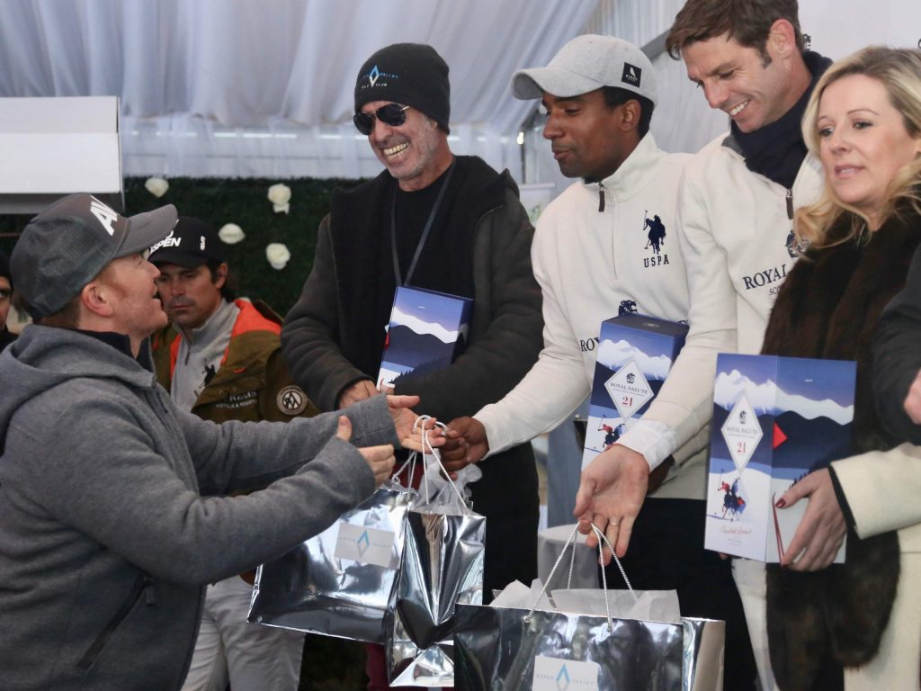 Marc Ganzi, left, greets players after the World Snow Polo Championship on Friday, Dec. 20, 2019, at Rio Grande Park in Aspen. (Photo by Austin Colbert/The Aspen Times)
