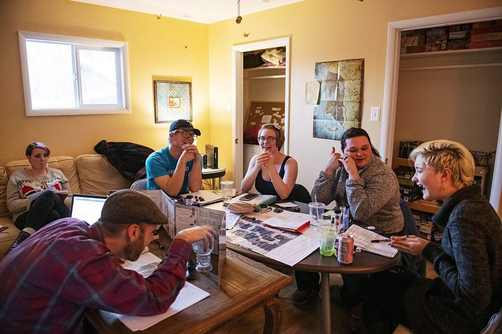A Dungeons and Dragons group meets in a room in the Stepping Stones building in Carbondale on Wednesday, December 11, 2019.