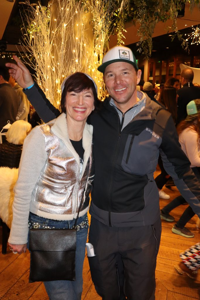 Longtime AVSC supporter Jackie Bucksbaum with event MC and pro skier Chris Davenport at the after party.