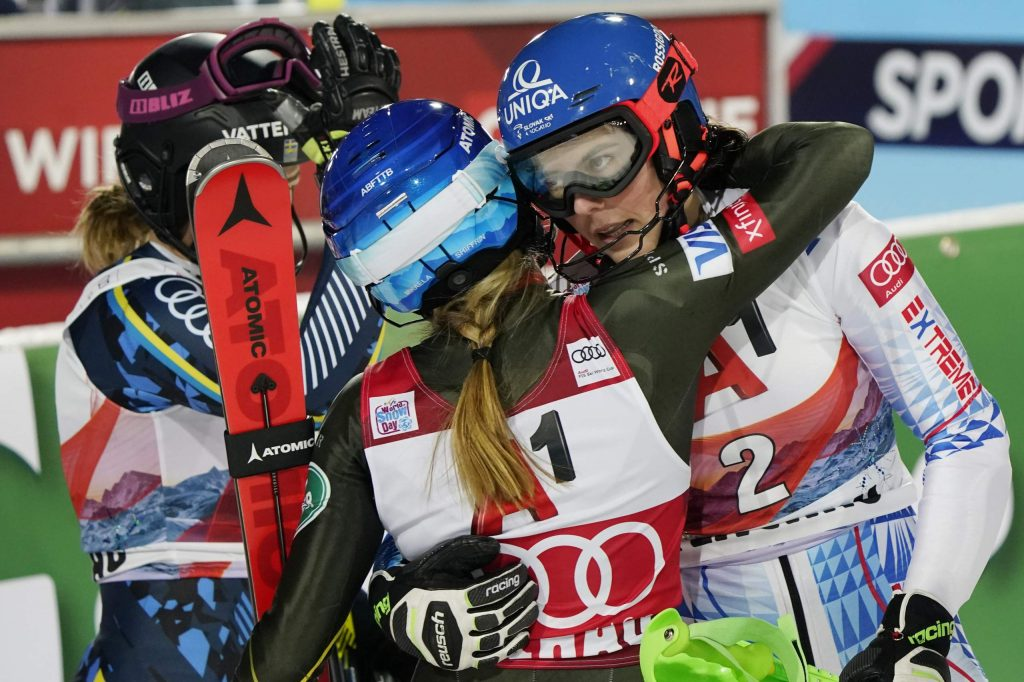 From left, second placed Sweden's Anna Swenn Larsson, third placed United States' Mikaela Shiffrin and the winner Slovakia's Petra Vlhova, celebrate after completing an alpine ski, women's World Cup slalom in Flachau, Austria, Tuesday, Jan. 14, 2020. (AP Photo/Giovanni Auletta)