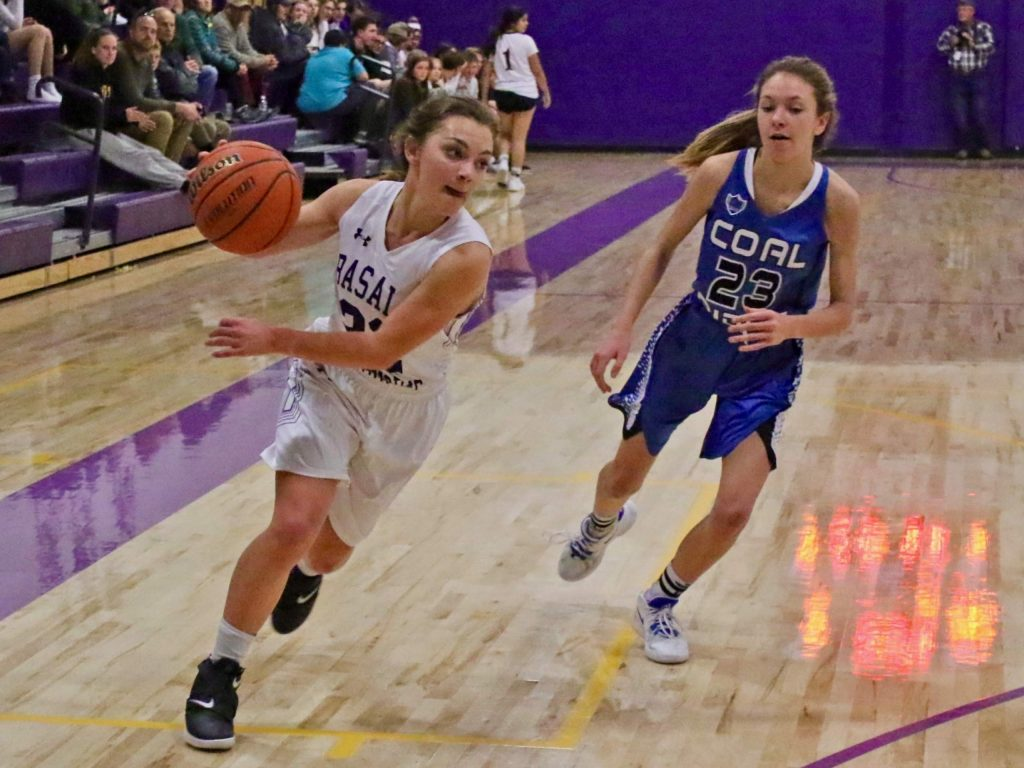 Basalt's Riley Webb, left, drives against Coal Ridge in the girls basketball game on Tuesday, Jan. 14, 2020, in Basalt. The Titans rolled to a 63-30 win.