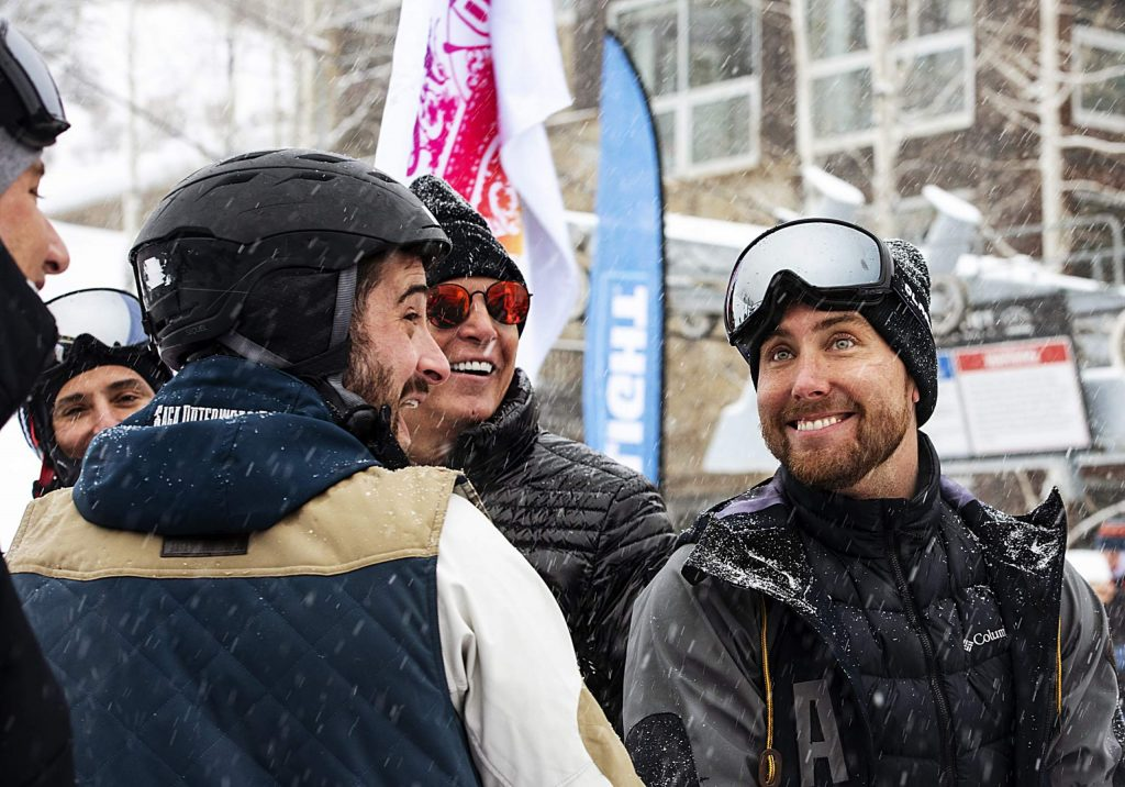 Former NSYNC band member Lance Bass, right, stands with his husband and representatives from Abbey during the Gay Ski Week downhill costume contest and party at the base of Aspen Mountain on Friday, Jan. 17, 2020. (Kelsey Brunner/The Aspen Times)