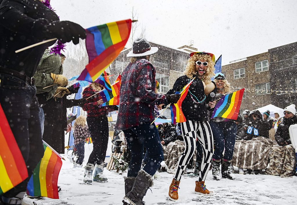 A team from Snowmass dances as Dolly Parton at the Gay Ski Week downhill costume contest and party on Friday, Jan. 17, 2020. (Kelsey Brunner/The Aspen Times)