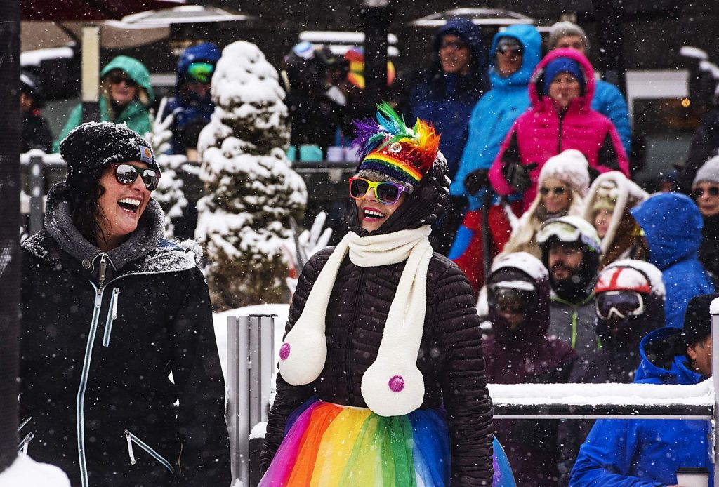 People watch the Aspen Gay Ski Week downhill costume contest at the base of Aspen Mountain on Friday, Jan. 17, 2020. (Kelsey Brunner/The Aspen Times)